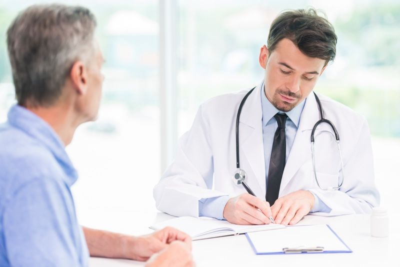 Fotografia Médico y paciente
