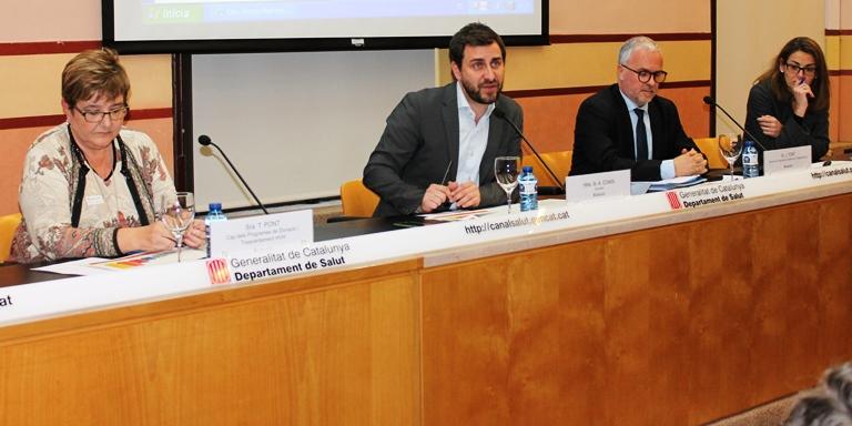 Foto de El conseller Com?n, entre Teresa Pont i Jaume Tort, aquesta