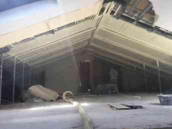 Foto de poliuretano proyectado bajo tejado con pizarra