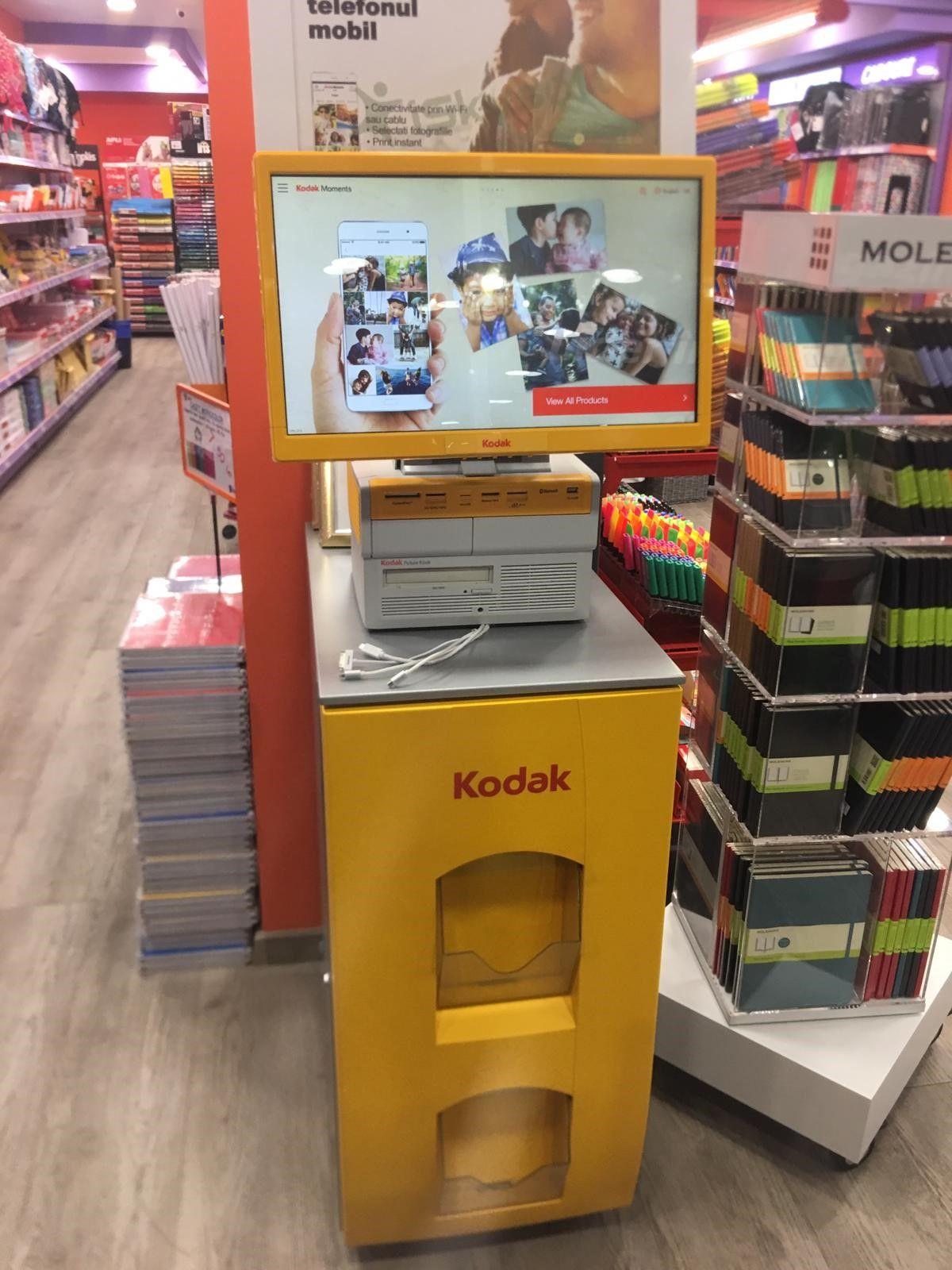 Foto de Kiosco Kodak en tiendas Folder